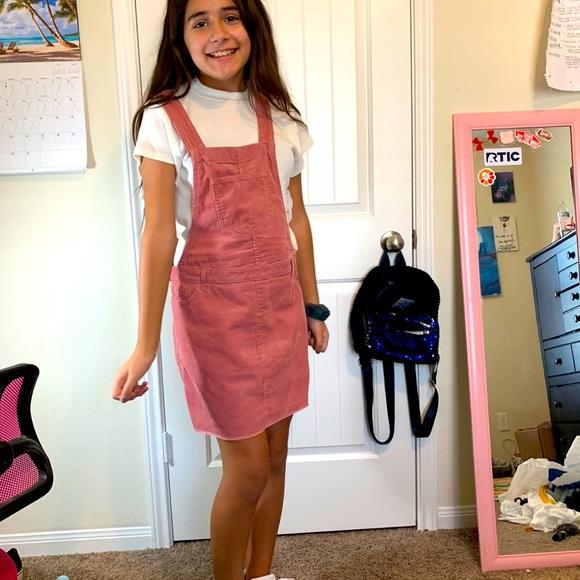 Pink corduroy overall dress